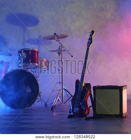 Rock band instruments on foggy background
