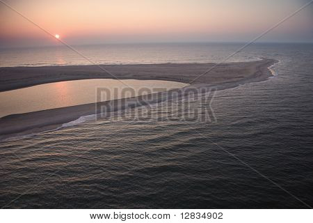 Scenic aerial view of sandbar at Baldhead Island, North Carolina at dusk.