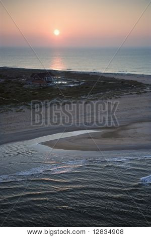 Scenic aerial view of Baldhead Island, North Carolina beach at dusk.