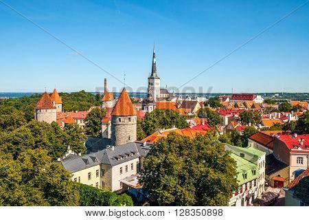 TALLINN, ESTONIA - AUGUST 12: Cityscape of old town Tallinn with bright roofs in sunlight. August 2015