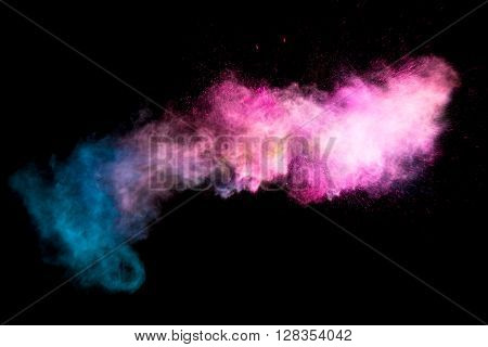 Colorful pink powders isolated on black background
