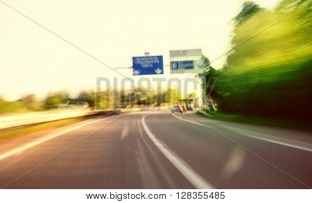 Moving fast on French highway under with beautiful film effect applied