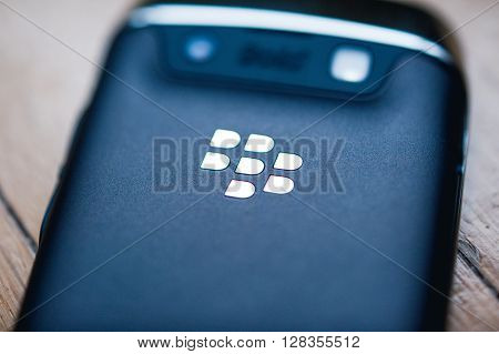 PARIS FRANCE - APR 21 2013: Rear view of a Blackberry phone with the chrome logotype. BlackBerry is a line of wireless handheld device with services designed and marketed by BlackBerry Limited formerly known as Research In Motion. Tilt-shift lens to focus