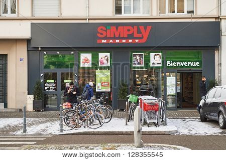 STRASBOURG FRANCE - JAN 20 2016: Modern SIMPLY Supermarket in the French city of Strasbourg on a snowy winter day - Simply Market is a brand of French supermarkets formed in 2005. The brand belongs to the Auchan Super subsidiary that manages the branches