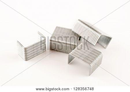 Four small staple stapler in white background