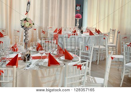Table arrangement for christening or wedding party with red color