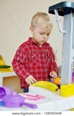 Toddler Playing Toy Kitchen