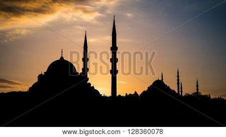 Silhouette of old town - Sultanahmet mosques in setting sun in Istanbul Turkey. Istanbul old town has many mosques to give a silhouette of minarets