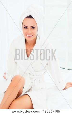 Portrait of beautiful woman wearing bathrobe and towel on head after shower