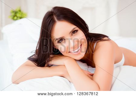 Close Up Portrait Of Beautiful Young Woman Lying In Bed