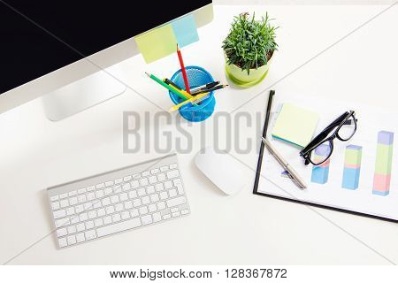 Close up photo of work place in office with pc