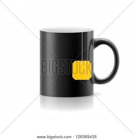 Black cup with tea bag label from standing on white background