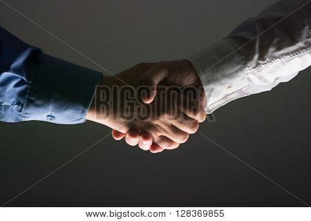 Two Businessman Handshake Handshaking between darkness and light