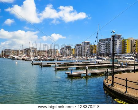 The moorings and luxury houses in harbor. Sovereign Harbour Marina Eastbourne East Sussex England