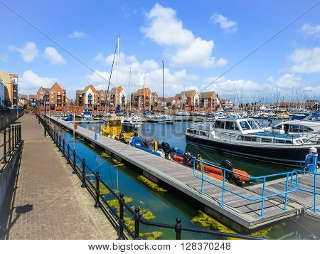 The moored yachts and luxury houses in harbor. Sovereign Harbour Marina Eastbourne East Sussex England