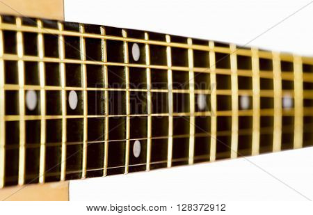Grif of an acoustic guitar close up on a white background