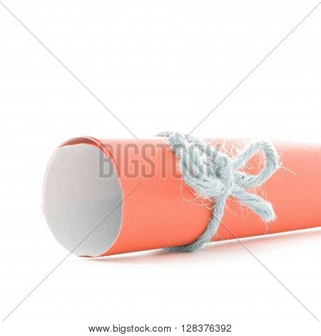 Handmade natural rope bow tied on orange paper scroll isolated