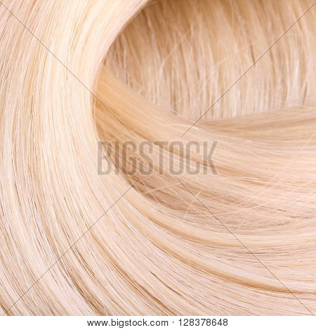 Blond hair extension macro. Close up shot