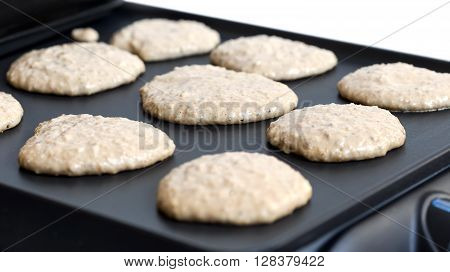 Oat Pancakes Cooking On Electric Barbecue
