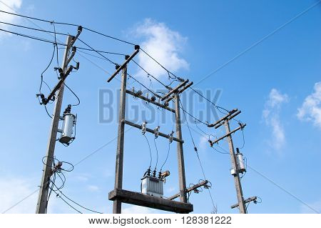 High Voltage Transformers and Electricity wire on the pole.