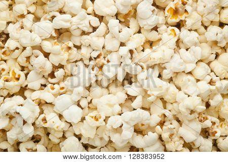 Closeup of a lot of plain popcorn