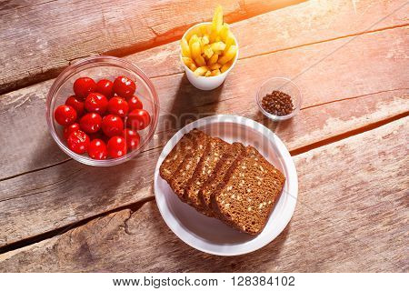 Bread and tomatoes with pepper. Food and pepper on table. Spice up your meal. Small homemade snack.