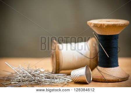two spools of thread with thimble, shallow depth of field