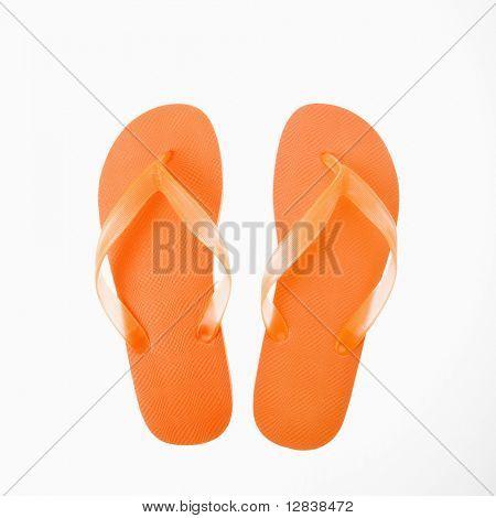 Orange plastic thong flip flops.