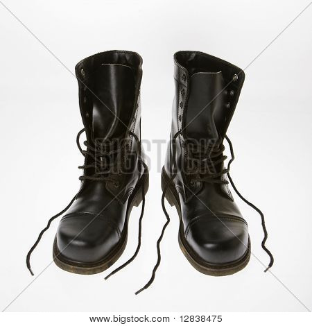 Black leather boots with laces untied.
