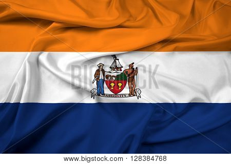 Waving Flag of Albany New York. Beautiful satin background.