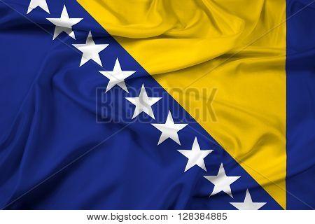 Waving Flag of Bosnia and Herzegovina. Satin background