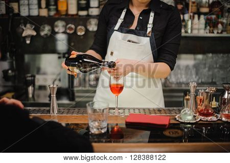 Bartender pouring champagne into glass close-up no face