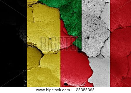 flags of Belgium and Italy painted on cracked wall