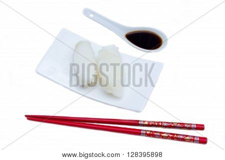 Nigiri with halibut on a white background seen from above