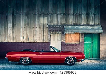 Adelaide Australia - April 30 2016: 1969 Ford LTD Convertible parked near the old barn in Port Adelaide