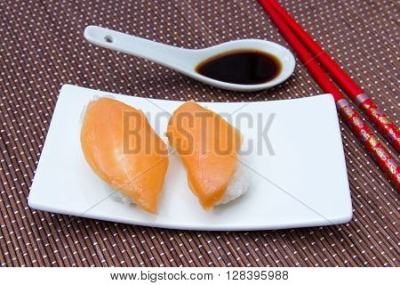 Nigiri with salmon on a placemat bamboo seen up close