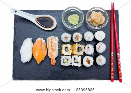 Sushi on flat slate on a white background seen from above