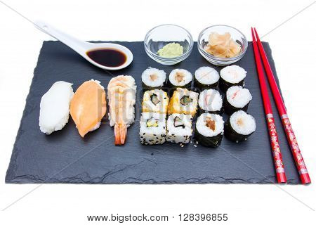 Sushi on a slate plate on a white background