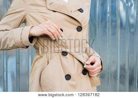 Woman In Beige Coat Tie Belt At The Waist