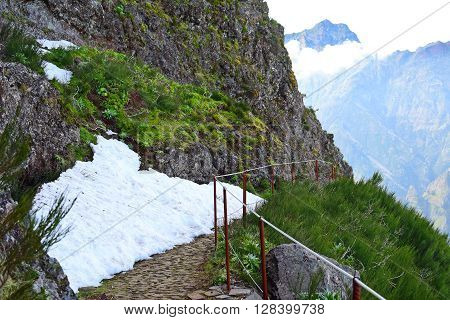 Snow on a trail in Madeiran mountains in the springtime