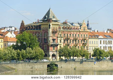 The view of Smetanovo Embankment in Prague at sunny summer midday