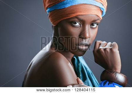Fashion-portrait of the beautiful black woman. Protest symbol against racism. Studio shot.