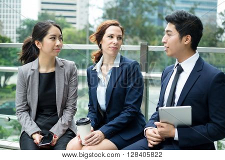 Business people sitting out of office and discuss together
