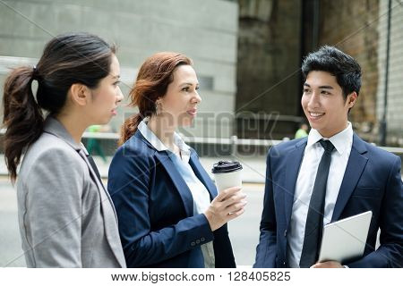 Business people talk to others