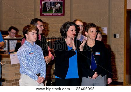 SHAKOPEE, MINNESOTA - APRIL 30, 2016: Congressional candidate Angie Craig (woman in middle clapping) awaits announcement of her nomination and endorsement by party members at organizing convention in Shakopee on April 30.