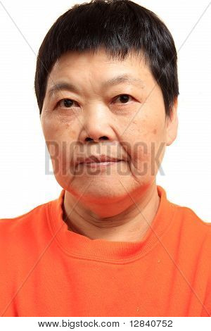 Portrait Of A Happy 60S Senior Asian Woman