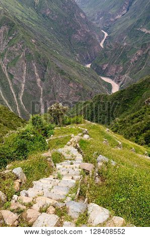 South America - Choquequirao lost ruins (mini - Machu Picchu) remote spectacular the Inca ruins near Cuzco. Cultivated terrace fields on the steep sides of a mountain
