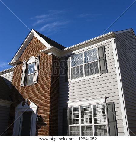 Exterior of brick and vinyl siding house.
