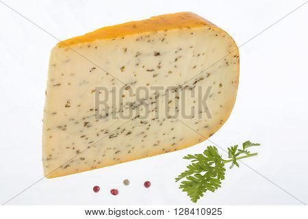 Portion of gouda with cuminon white background