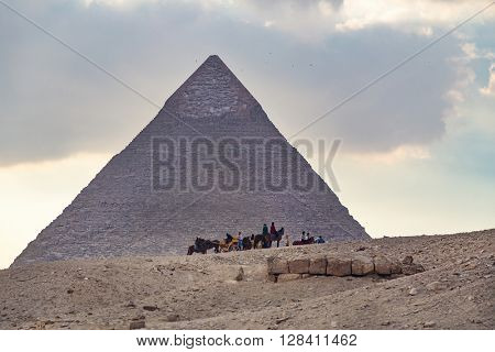 CAIRO, EGYPT - FEBRUARY 2, 2016: Tourists on horses in front of the Great pyramid of Giza.